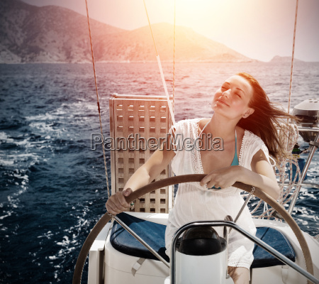 woman behind the wheel yacht