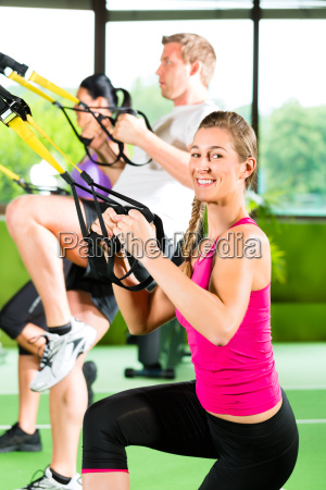 people in sport gym on suspension