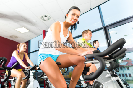 people spinning in a gym