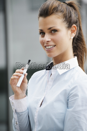 portrait of young woman smoking electronic