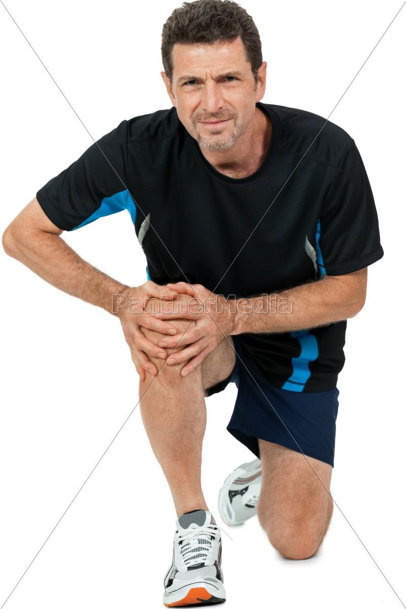 erwachsener sportlicher mann mit knieproblemen sport lizenzfreies foto 9714384. Black Bedroom Furniture Sets. Home Design Ideas