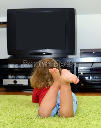 child is watching tv