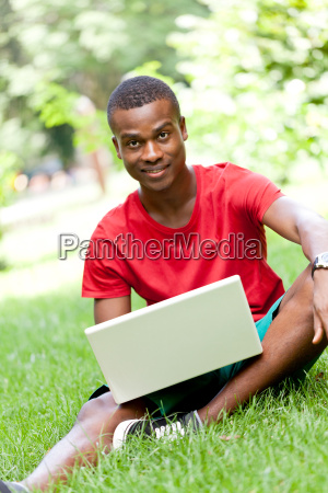 young adult man student sitting in