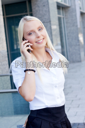 young blond woman using a cellphone
