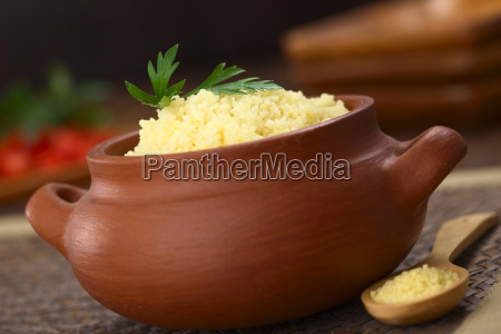 prepared couscous in rustic bowl
