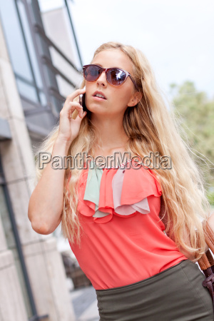 young beautiful blonde woman with sunglasses