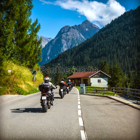 group of bikers on the road