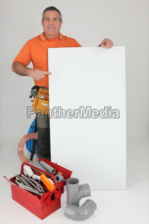 plumber with materials and a board