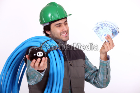 plumber holding his wages