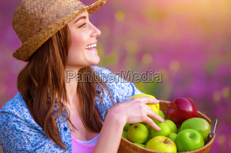 happy woman with apples basket