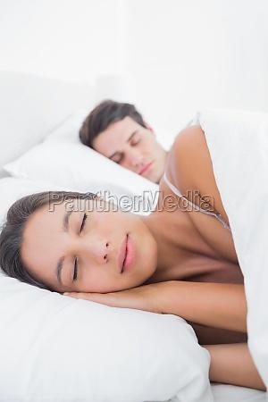 beautiful woman sleeping next to her