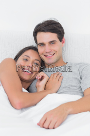 pretty woman embracing her partner in