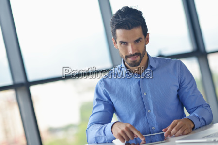 business man using tablet compuer at