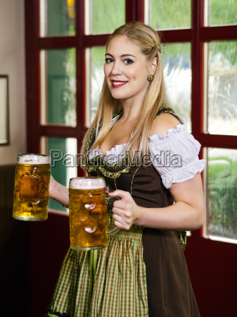 oktoberfest waitress serving beer