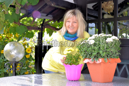 woman with autumn flowers under the