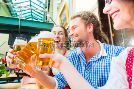 people in bavarian costume in an