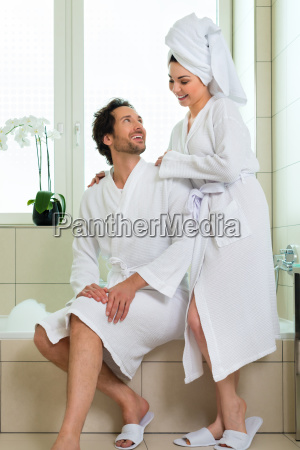 young couple in bathrobe in hotel