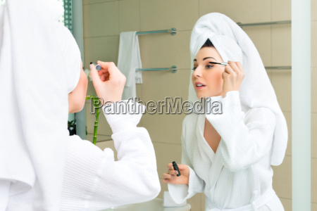 young woman in bathrobe at hotel