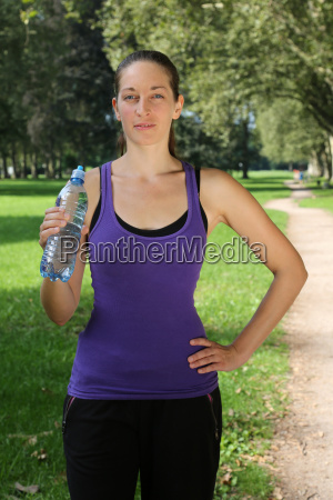athlete with water bottle