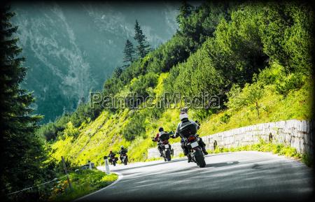 group of moto bikers on mountainous