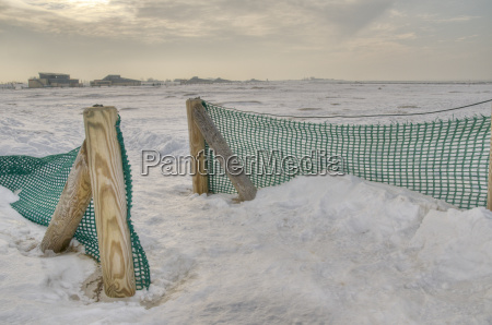 fence by the winter beach