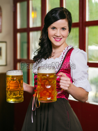 beautiful oktoberfest waitress with beer