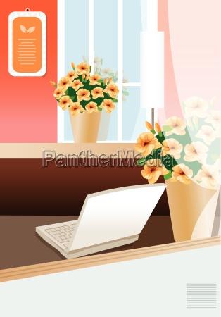 laptop auf einer tabelle des direktors