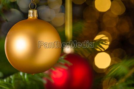 gold christmas ball hanging on xmas
