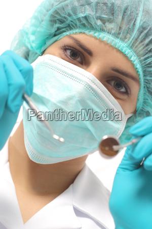 nahaufnahme von einem zahnarzt frau mit