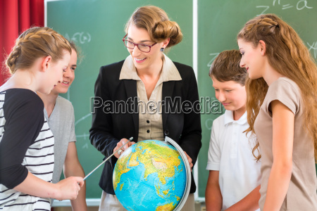 teacher teaches students of a class