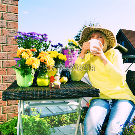woman sitting comfortably on the balcony