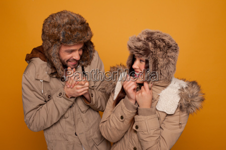 happy couple in warm winter clothing