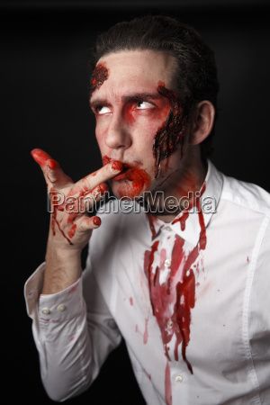 man is licking blood