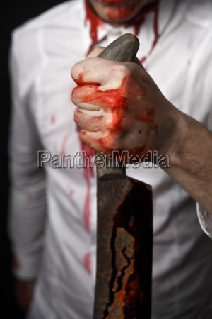 man holding a bloody knife in