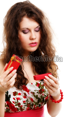 girl opening small red gift box
