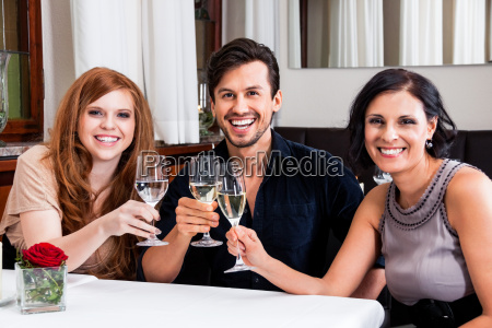 mixed group of people laughing at