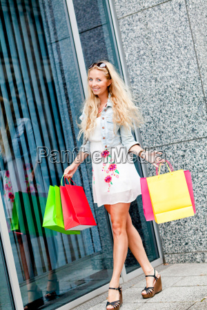 young laughing blonde woman with colorful