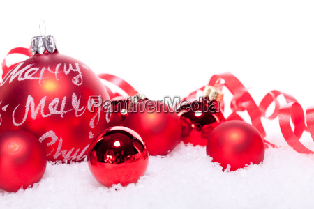 christmas bauble decoration in snow isolated