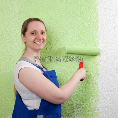 smiling woman with paint roller