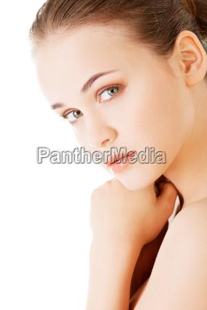 attractive naked woman looking at camera