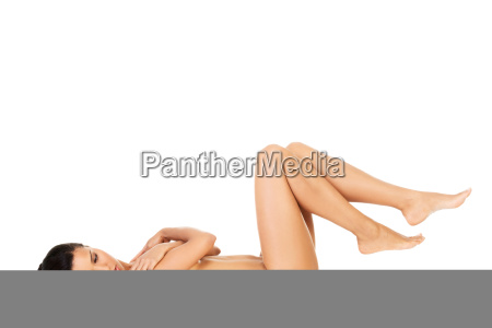 naked attractive woman lying on her
