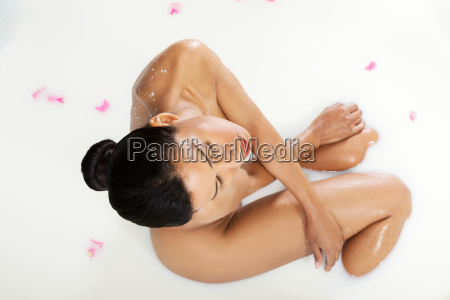 attractive naked woman lying in a