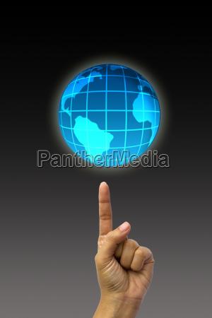 konzept hand zeigen erde globus