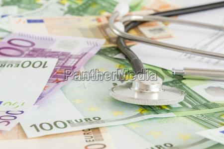 money and stethoscope medical insurance