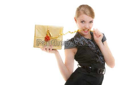blond girl with golden christmas gift