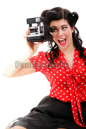 excited retro girl with vintage camera