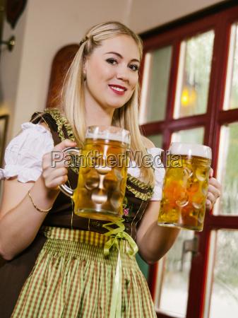 serving beer at oktoberfest