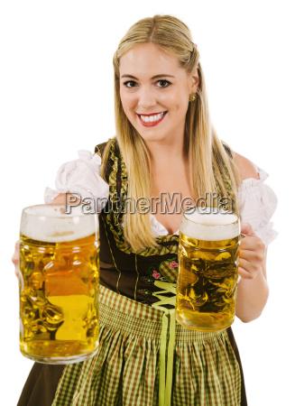 happy blond serving beer during oktoberfest