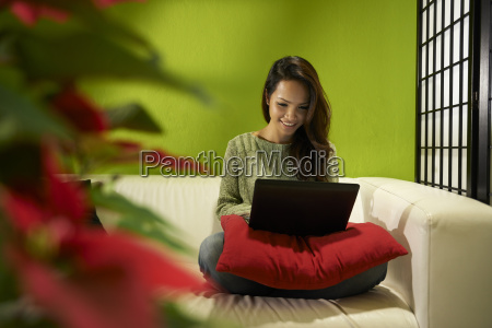 asian girl with computer sitting on