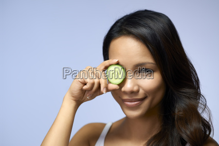 asian girl using beauty cream and